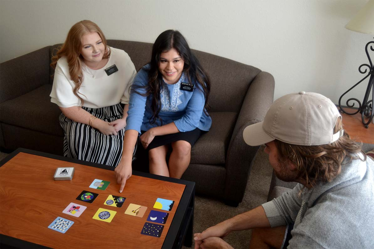 sister missionaries using plan of salvation cards